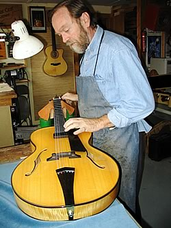 Oskar with a new archtop guitar